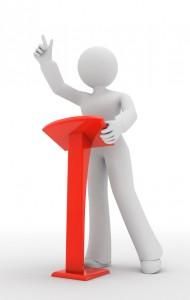speaking-at-podium